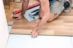 Floor installation. Home improvement, new floor installation Royalty Free Stock Photo