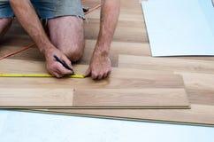 Floor installation. Home improvement, new floor installation Royalty Free Stock Photos