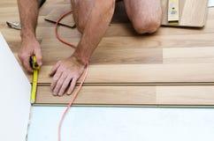 Floor installation. Home improvement, new floor installation Stock Photo