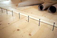 Floor installation in a house. Screws lined up before tightening Royalty Free Stock Photos