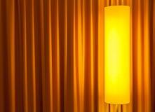 Floor lamp ahead curtain Royalty Free Stock Photo
