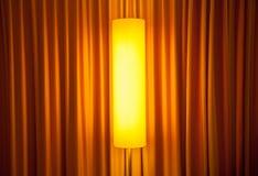 Floor lamp ahead curtain Royalty Free Stock Photos