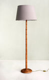 Floor Lamp with Bamboo Base and Pale Purple Shade Stock Photo