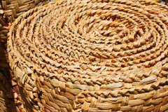 Floor mat made from woven reeds Stock Images
