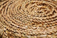 Floor mat spirals and texture. (made from woven reeds background stock photography