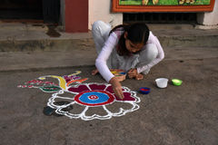 Floor Painting for Festival. An adolescent girl doing painting for their own festival   at Purulia-India Stock Photos