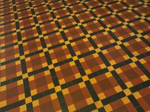 Floor with pattern in a red, yellow and black tiles. A floor with pattern in a red, yellow and black tiles stock images