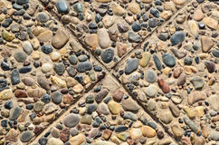 Floor paved with pebbles and stone brace tiles Royalty Free Stock Photography