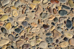 Floor paved with pebbles and stone tiles Stock Photo