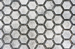 Floor with paving stones and hexagon shapes Stock Images