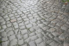 Floor of paving stones wet from the rain Stock Photo