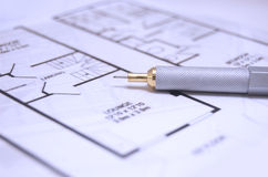 Floor Plan. Close up of house floor plan with stylish steel and gold pencil. Shallow DOF, focus on the pencil nib Stock Photo