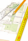 Floor plan [4]. Pencil, tape measure and a ruler on top of a floor plan; Shallow depth of field with focus on pencil's tip royalty free stock images