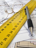 Floor plan. A pencil and geometric tools on top of a floor plan royalty free stock photo