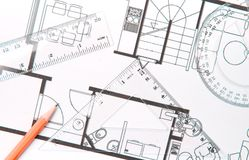 Floor plan. A pencil, setsquare and a protractor on top of builing plan Royalty Free Stock Photo
