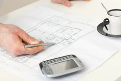 Floor plan on architect's desk Royalty Free Stock Photo