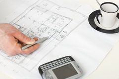 Floor plan on architect's desk Stock Images