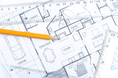 Floor plan [horizontal]. Topview of a pencil and geometric tools on top of floor plan stock photo