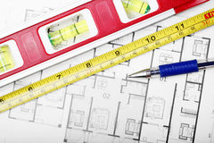 Floor plan and tools. Tape measure, ball-pen and other tools on the floor plan stock photography