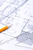 Floor plan [vertical]. Setsquare, pencil and a ruler on top of a floor plan. Focus on numbers on the setsquare stock image