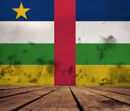 Texture of the Central African Republic flag. The floor of planks and plastered wall with a painted Centralo African Republic flag stock photography