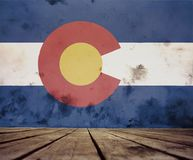 A painted Colorado flag. The floor of planks and plastered wall with a painted Colorado flag stock images