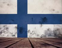 Finland flag on the wall. The floor of planks and plastered wall with a painted Finland flag royalty free stock images