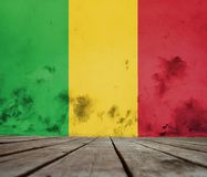 Texture of Mali flag. The floor of planks and plastered wall with a painted  Mali flag Stock Photos