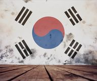 Texture of South Korea flag. The floor of planks and plastered wall with a painted South Korea flag stock images