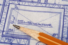 Floor Plans. Architecture Plans - blueprint with pencil royalty free stock photos