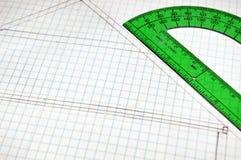 Floor Plans on grid paper. Rough sketch of house Floor Plans on grid paper with green ruler stock image
