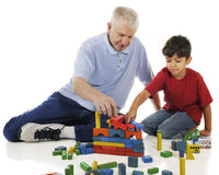 Floor Play with Grandpa Royalty Free Stock Image