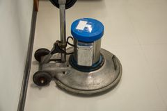 Floor polishing machine. The Floor polishing machine in room royalty free stock photography
