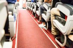 Floor proximity reflector line aids airplane evacuation under da. Rk or smoky conditions Stock Image
