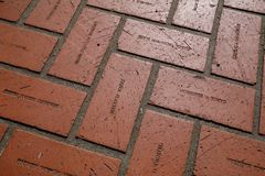 Floor red bricks with engraving names at Pioneer Courthouse Square in Portland. Portland, Oregon, USA - April 20, 2018 : Floor red bricks with engraving names at royalty free stock photos