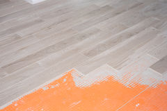 Floor renovation with ceramic tiles in wood design Stock Images