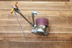 Floor sanding. Machine on a hardwood floor Stock Image