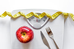 Floor scale and apple on white background top view Stock Photos