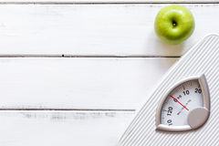 Floor scale and apple on wooden background top view Royalty Free Stock Image