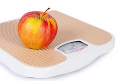 Floor scales with apple. Diet concept Stock Image
