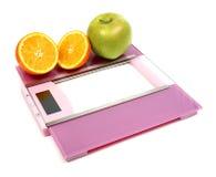 Floor scales apple and orange Stock Photos
