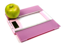Floor scales and green apple Stock Photography