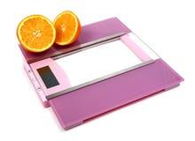 Floor scales and orange Royalty Free Stock Photo