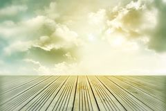 Floor and sky. Wooden floor leading to bright sky Stock Photo