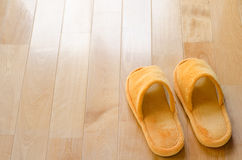 Floor and slippers Stock Photography