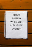 Floor slippery when wet use caution sign Stock Image