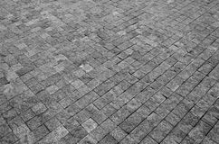 Floor of a street with stone tiles. As background Stock Image