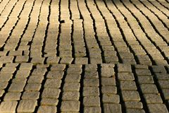 Floor, texture, sun, brick, background, rough, light, sidewalk, architecture, surface, pavement, abstract, concrete, paving, stone. Hard, pattern, cement, red royalty free stock photos