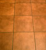Floor tile. Modern, brown floor tiles in a kitchen Royalty Free Stock Photo