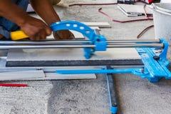 Floor tile installation. Construction mason worker floor tile installation. Home improvement Stock Photos
